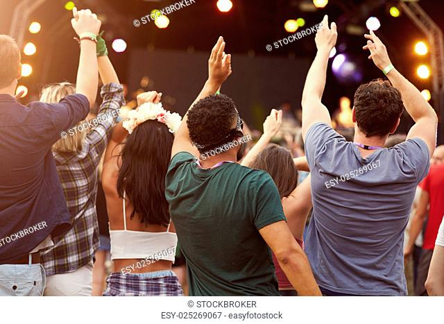 Back view of audience at a music festival
