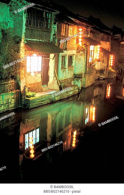 Illuminated houses by river at night, Xitang Town, Jiashan County, Jiaxing City, Zhejiang Province of People's Republic of China