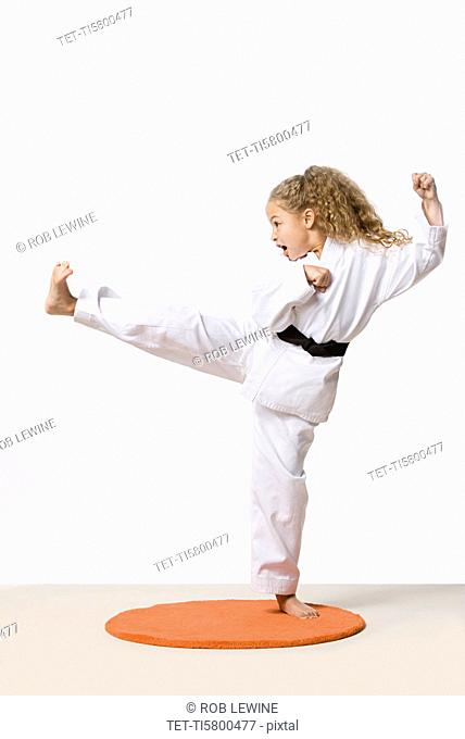 Girl 8-9 training martial arts, studio shot