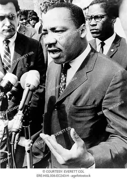Martin Luther King, Jr. 1929-1968, speaking at an informal news conference in Selma, Alabama, 1965