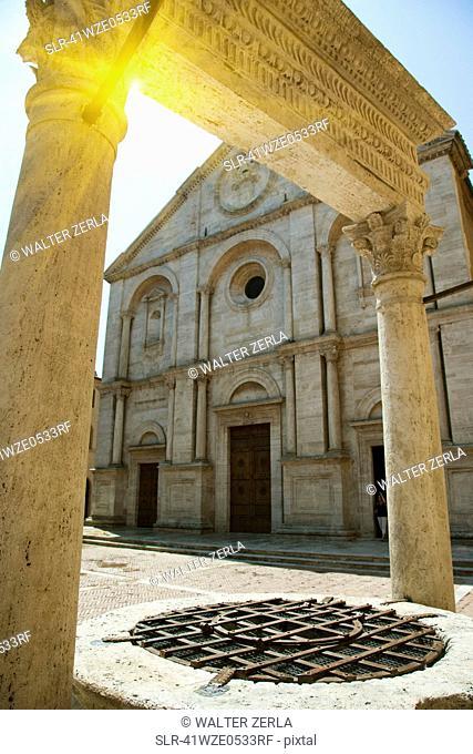 Sun shining through ornate archway