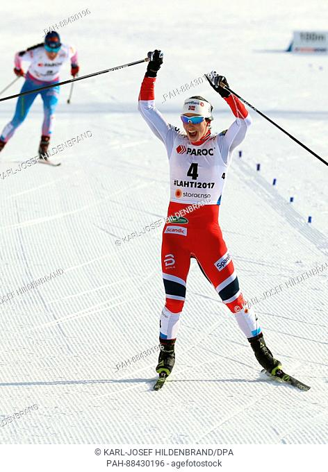 Marit Bjoergen of Norway reaches the finish line before Krista Parmakoski of Finland during the women's 2 x 7.5km cross-country event at the 2017 Nordic World...