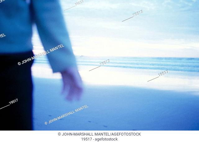 Person strolls on beach