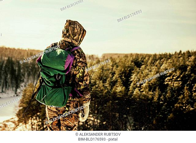 Caucasian hiker standing on hilltop
