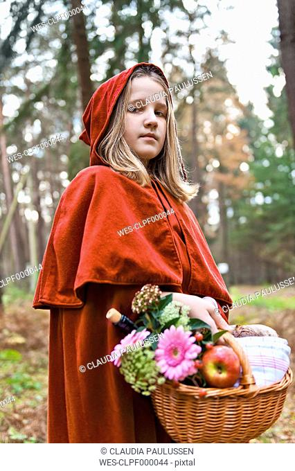 Portrait of girl masquerade as Red Riding Hood