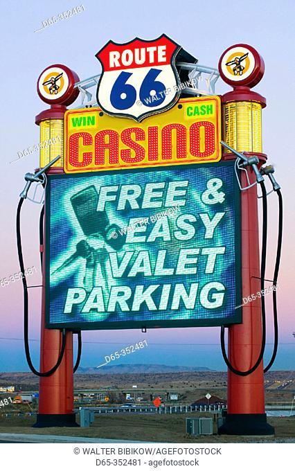 Route 66 travel center and casino neon sign. Rio Puerco. New Mexico, USA