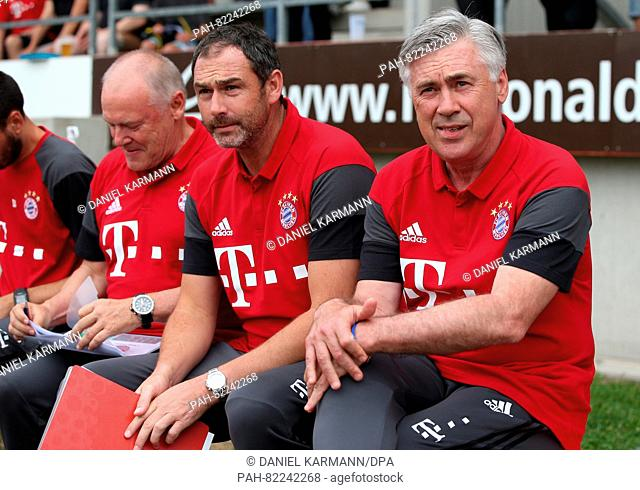 Co-Trainer Hermann Gerland (l-r), Co-Trainer Paul Clement and coach Carlo Ancelotti from Bayern Munich sit on the bench during a test match against SpVgg...