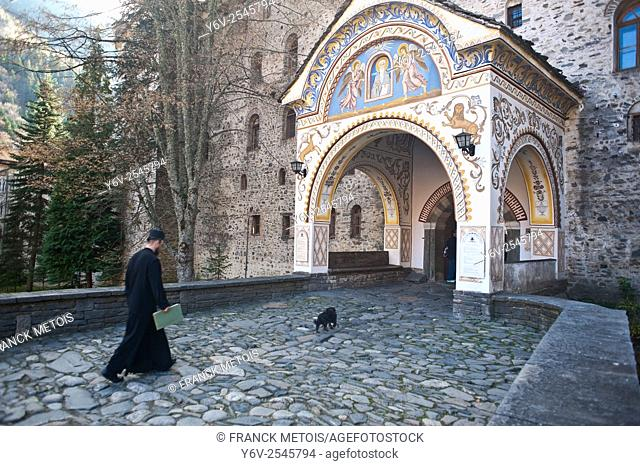 Orthodox monk entering into the Rila monastery. Rila ( Bulgaria)