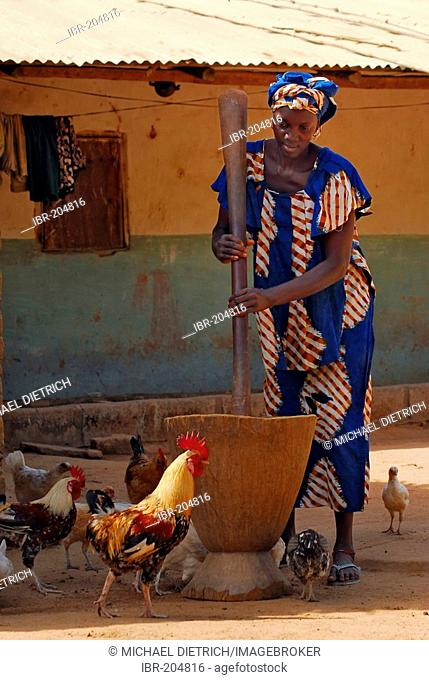 Young Jolla woman mashing cassava, Tumani Tenda, The Gambia