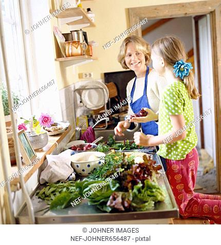 Mother and daughter with vegetables, Sweden