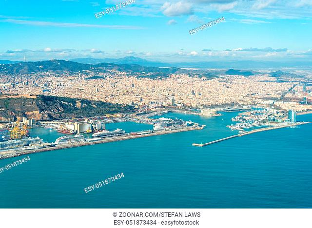 Aerial image from the city Barcelona with a sea of houses and urban canyons and all the landmarks and monuments. Barcelona is very popular and one of the most...