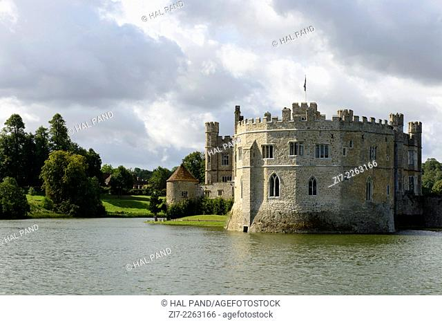 Leeds castle north side, Maidstone, England view of the northern side of medieval castle and its moat, shot in bright light under a cloudy sky