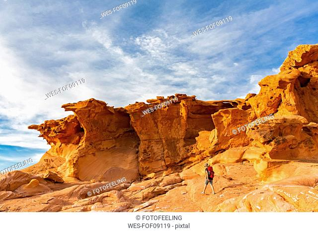 USA, Nevada, Little Finland, hiker in front of sandstone rock formations