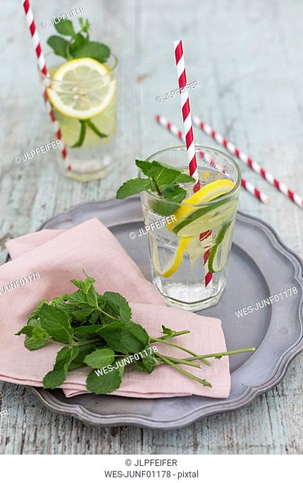 Glasses of infused water with lemon, lime and mint