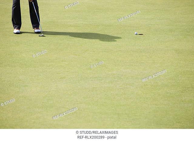 Man playing golf, The Royal and Ancient golf course, St. Andrews, Fife, Scotland