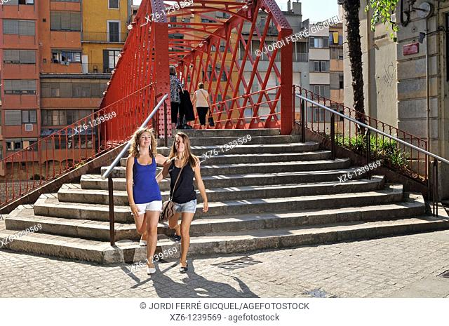 Two girls walking front the Eiffel bridge in Girona, Catalonia, Spain, Europe