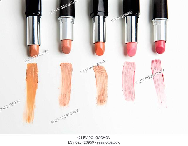 cosmetics, makeup and beauty concept - close up of lipsticks range