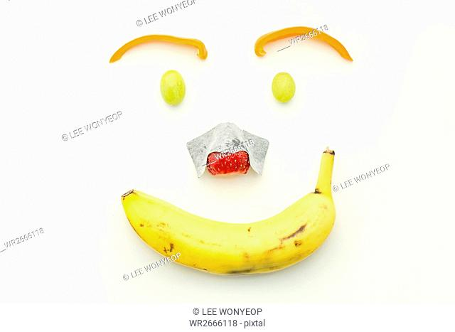 Smiling face made with fruits and vegetables, food art