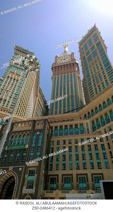Picture of Makkah Clock Tower, It is a tower containing the hotels overlooking the Kaaba and at its peak clock and panel containing Koranic verses written on...