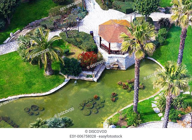 Aerial image of a beautiful tropical garden and a seating area in the center