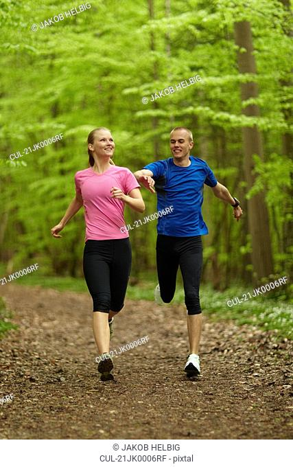 Man and woman running, competing