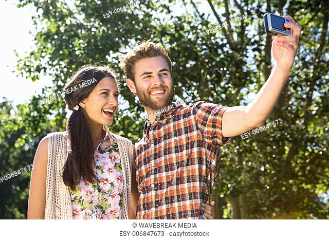 Hipster couple taking a selfie