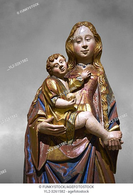 Gothic statue of The Virgin Mary (Madonna) holding the baby Jesus. Polychrome and gold leaf on wood by the Circle of Gil de Siloe around 1500