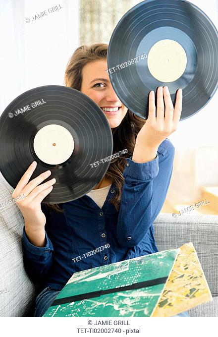 Woman holding two vinyl records