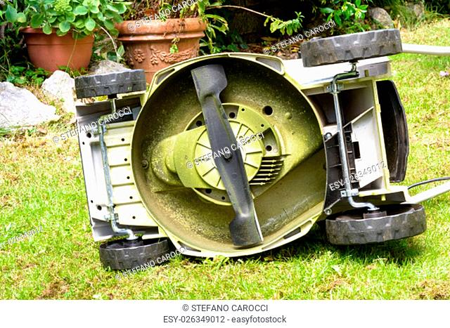 Rotating blades in the bottom of a Lawnmower