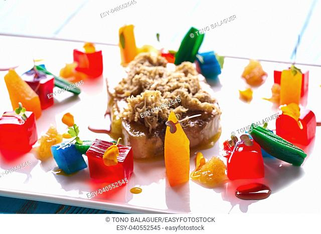 Foie slice with grated white truffle and colorful jelly decoration