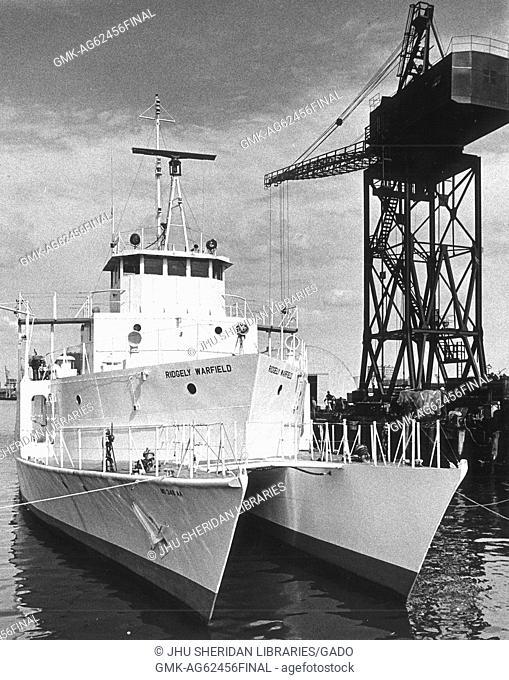 Chesapeake Bay Institute, Ridgely Warfield [Research Vessel] Ridgely Warfield docked beside large crane, 1980