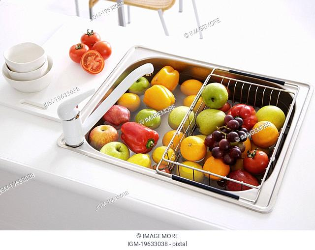 Fresh fruits in kitchen sink, elevated view