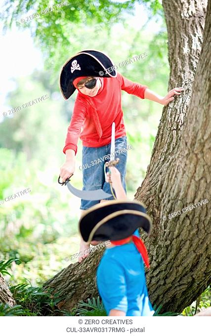 Boys playing in pirate costume