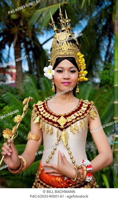 Cambodia, Siem Reap, Young woman wearing traditional dancer attire