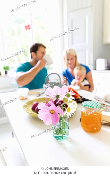 Breakfast on table, family on background