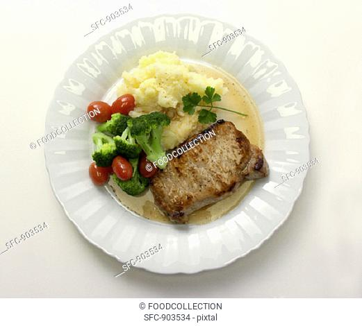 Boneless Pork Chop with Gravy and Mashed Potatoes