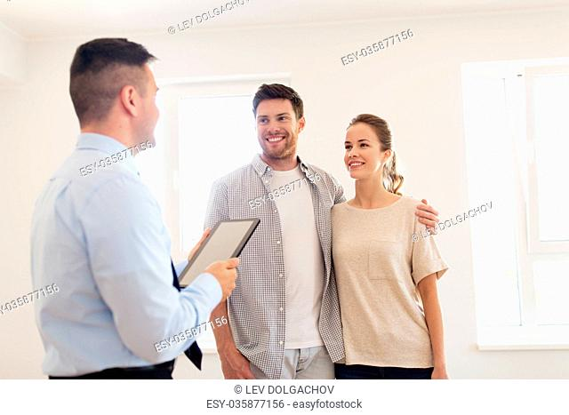 mortgage, people and real estate concept - happy couple and realtor with tablet pc computer at new home
