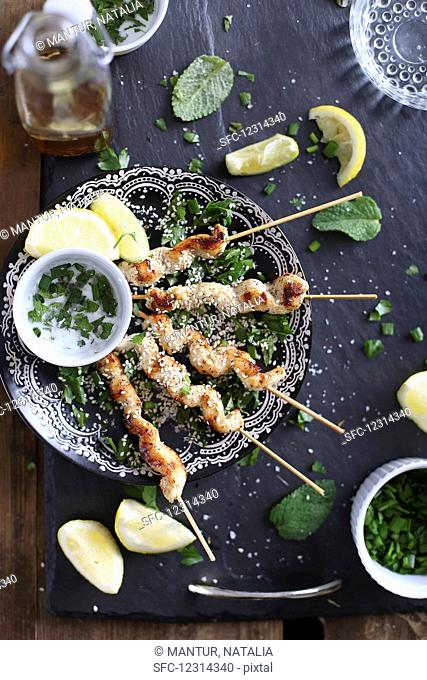 Chicken Shishkebabs with mint, sesme seeds and lemon wedges