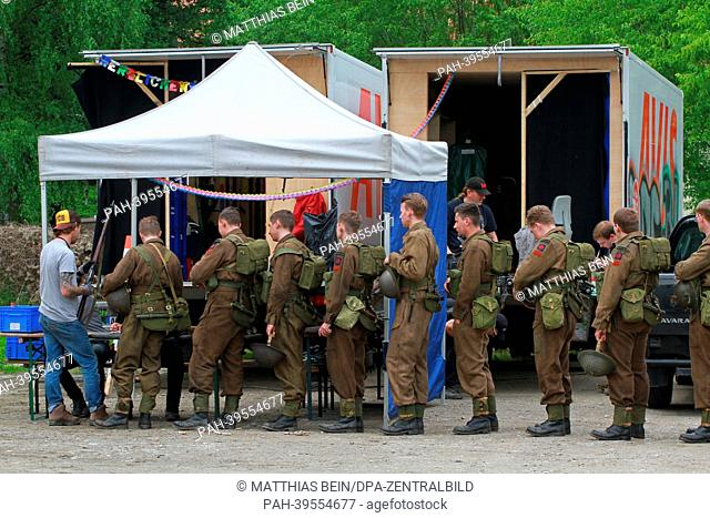 Extras wait in line at a meeting place in Osterwieck, Germany, 16 May 2013. Amercan actor George Clooney is filming his movie'The Monuments Men' in Osterwieck...