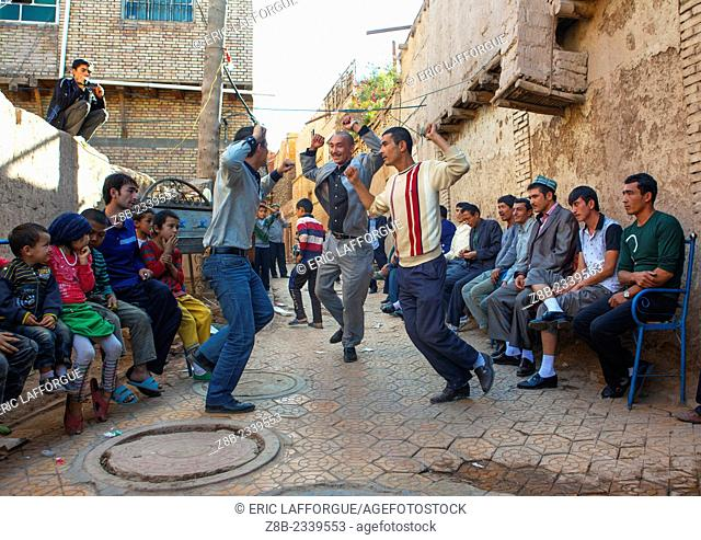Men dancing in the street during a Wedding In Uyghur Family, Kashgar, Xinjiang Uyghur Autonomous Region, China
