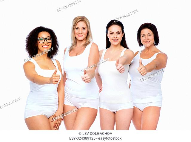 gesture, friendship, beauty, body positive and people concept - group of happy different women in white underwear showing thumbs up