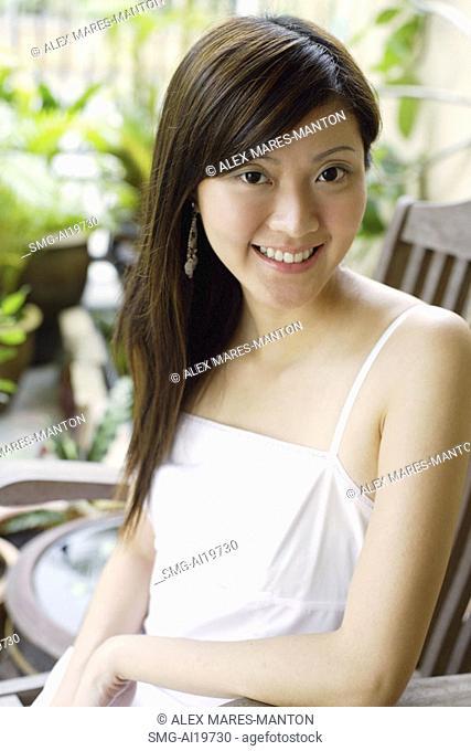 Woman sitting, looking at camera