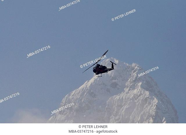 Germany, Bavaria, air display, aerobatics, helicopter, mountaintop, winter