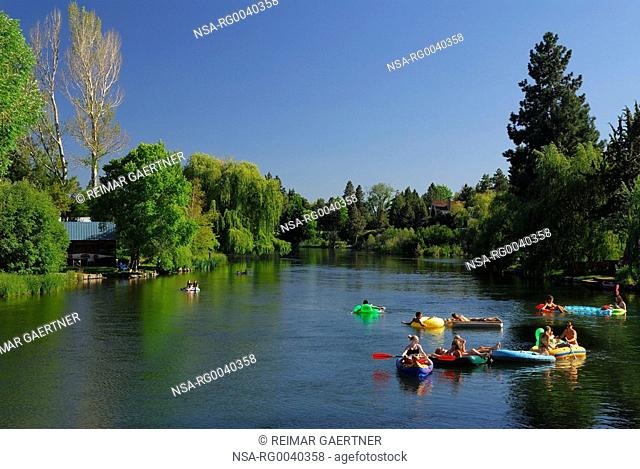 Teenager floating party on the Deschutes River in Bend Oregon