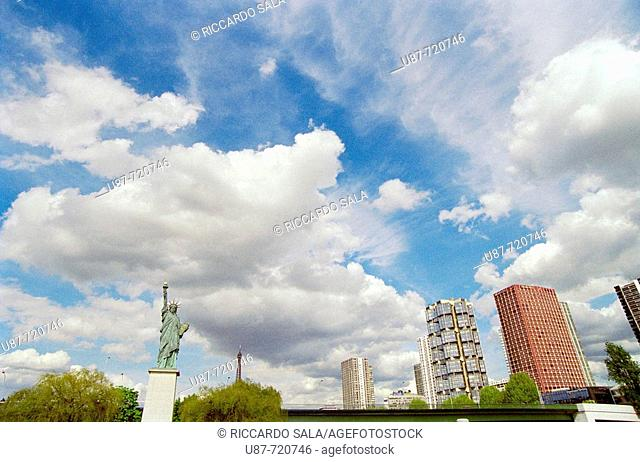 Modern buildings on 'Front de Seine' area and Statue of Liberty by sculptor Bartholdi on Seine River, Paris, France