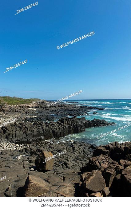 Lava rock formations along the coast of Iguana Island in Panama