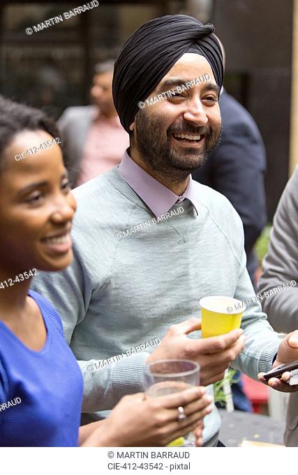 Smiling man in turban enjoying party