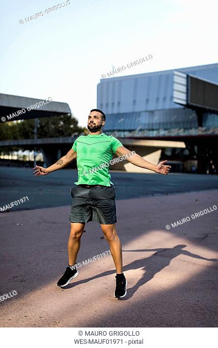 Sportive man during workout, jumping jack