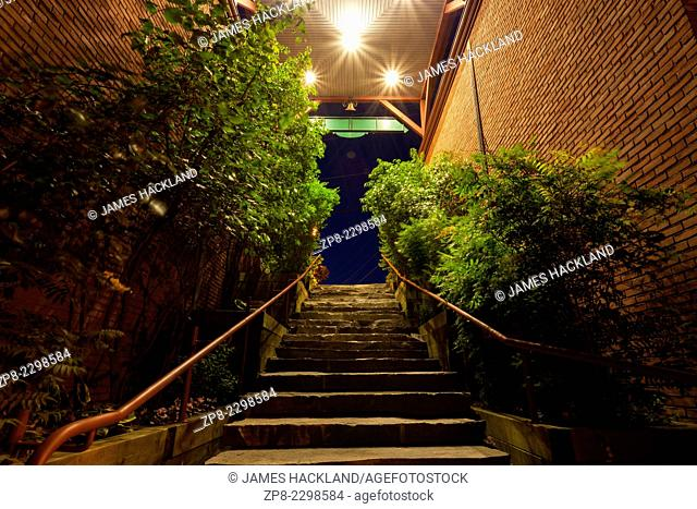 The Wallis Mill Laneway Stairs. Looking up towards Maple Street in downtown Port Carling at dusk. Ontario, Canada