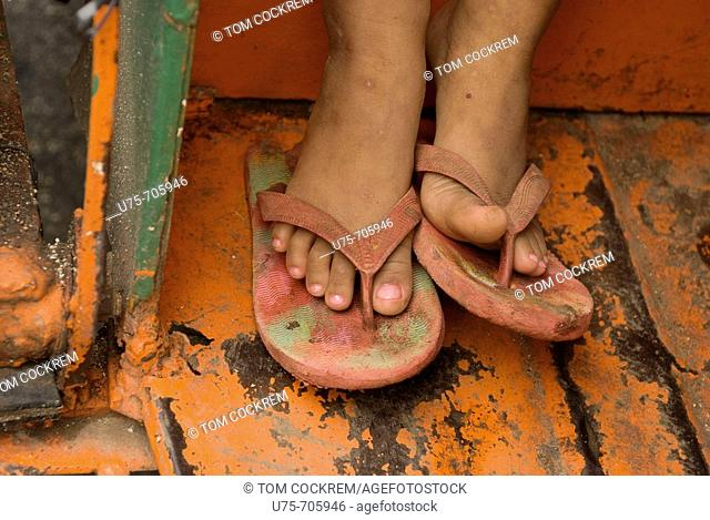 child's feet in tricycle taxi, Siquijor Island, Philippines